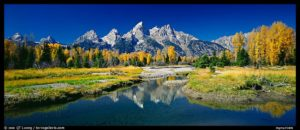Mountains and fall colors reflected in pond, Schwabacher Landing. Grand Teton National Park, Wyoming, USA.